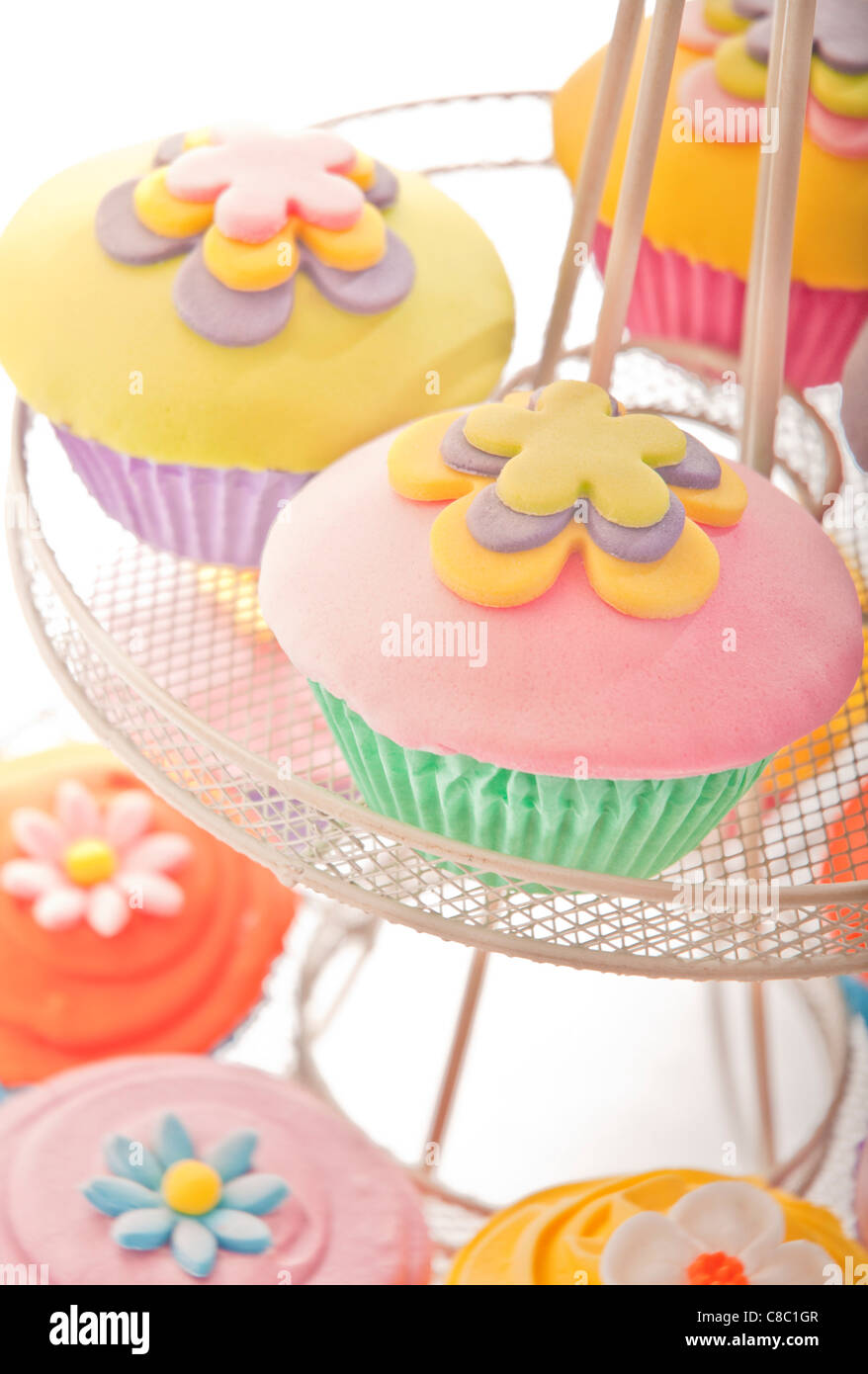 Bright Colourful Yellow Pink Flower Cupcake Cup Cakes On Stand On