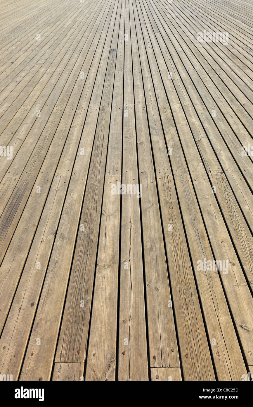 Wooden planks that make up a large pier. - Stock Image