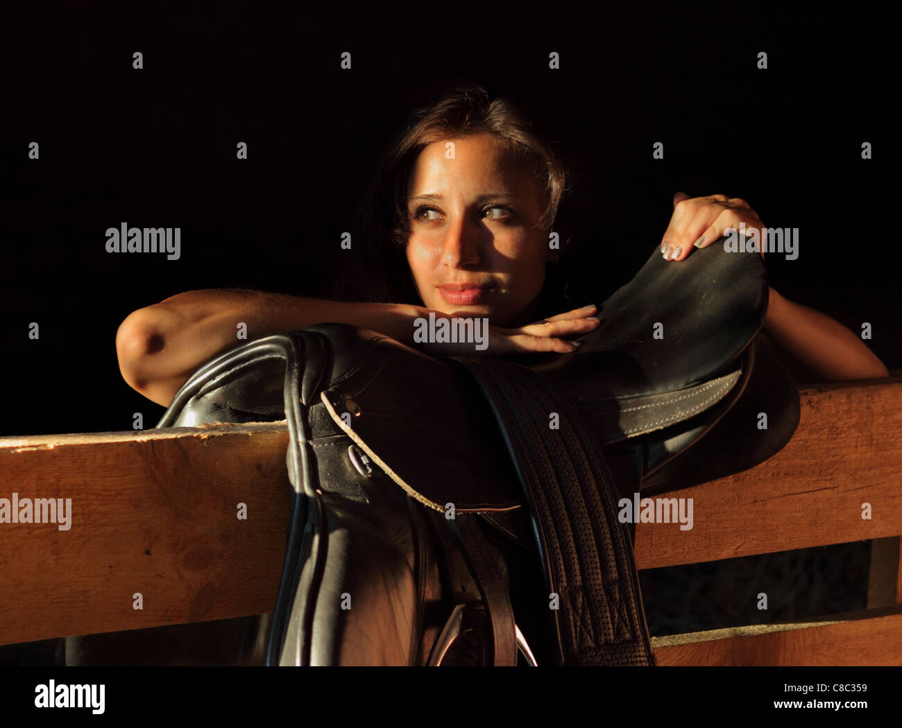 Women and Old English Saddle - Stock Image