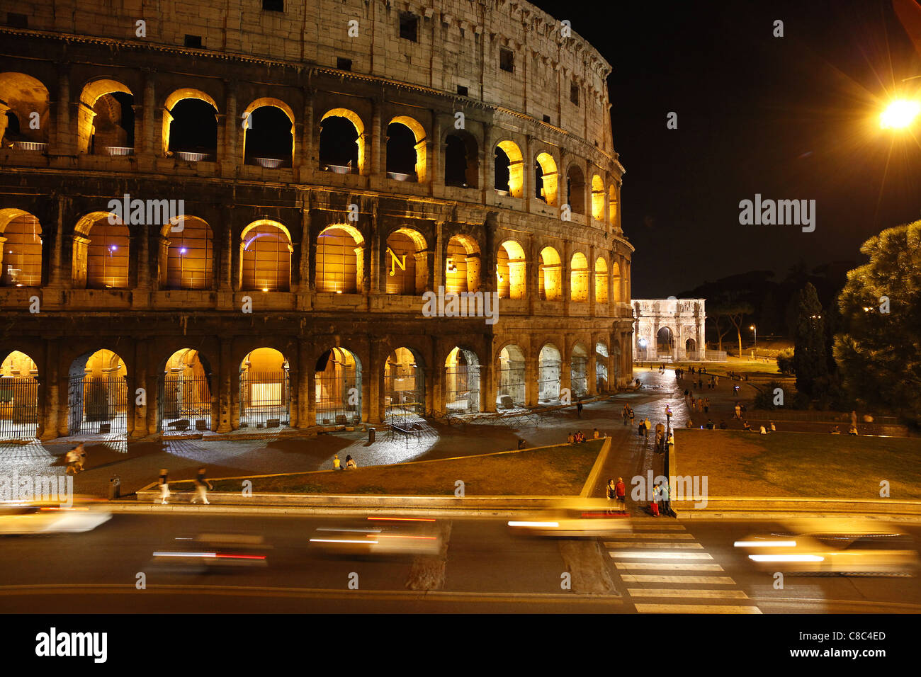 Traffic passing the Colosseum in Rome, Italy. - Stock Image