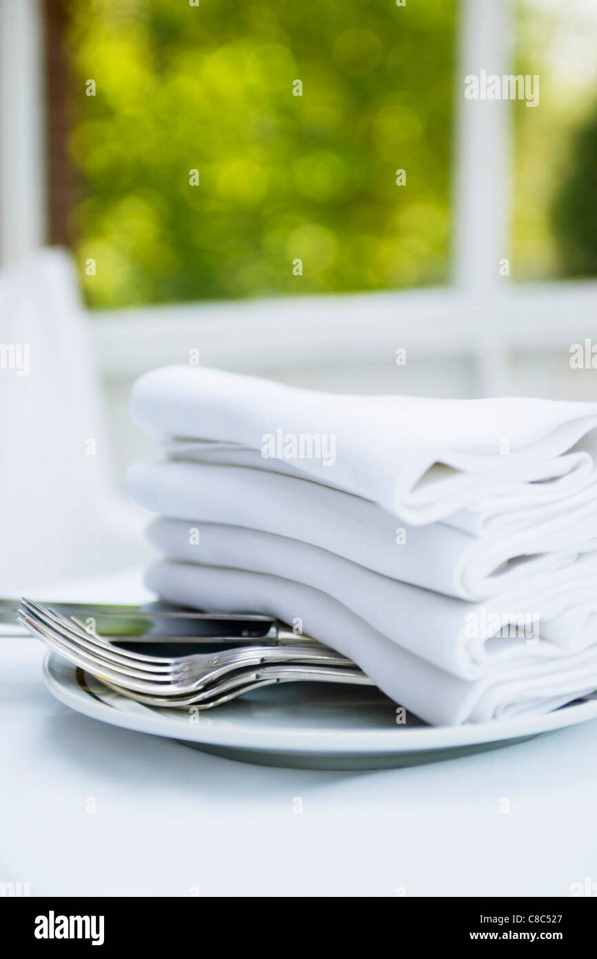 pile of napkins on table - Stock Image