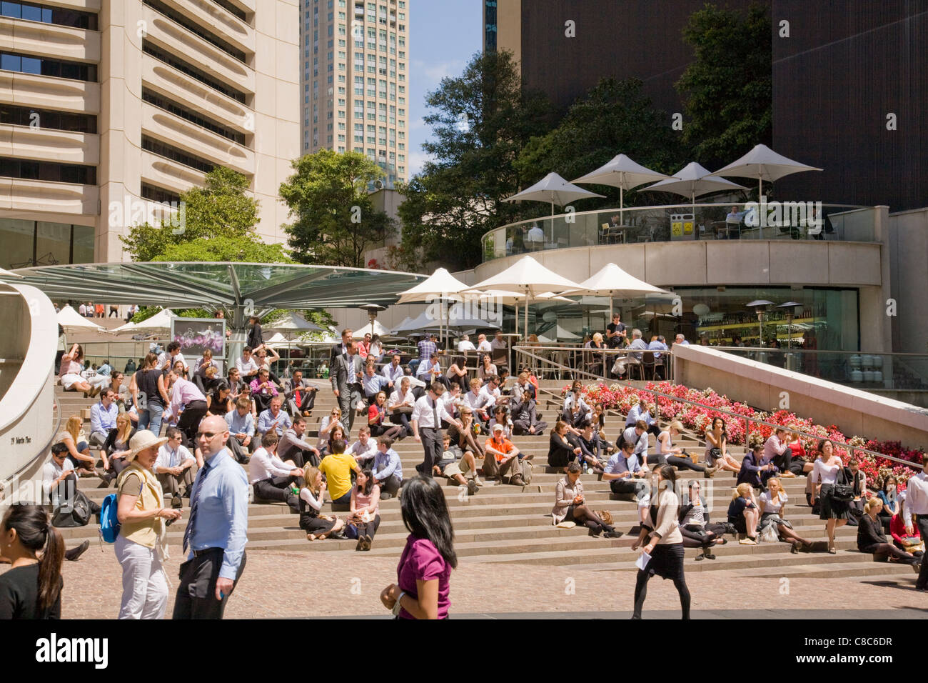office workers taking their lunch break, steps of the MLC centre in sydneys business district,australia - Stock Image