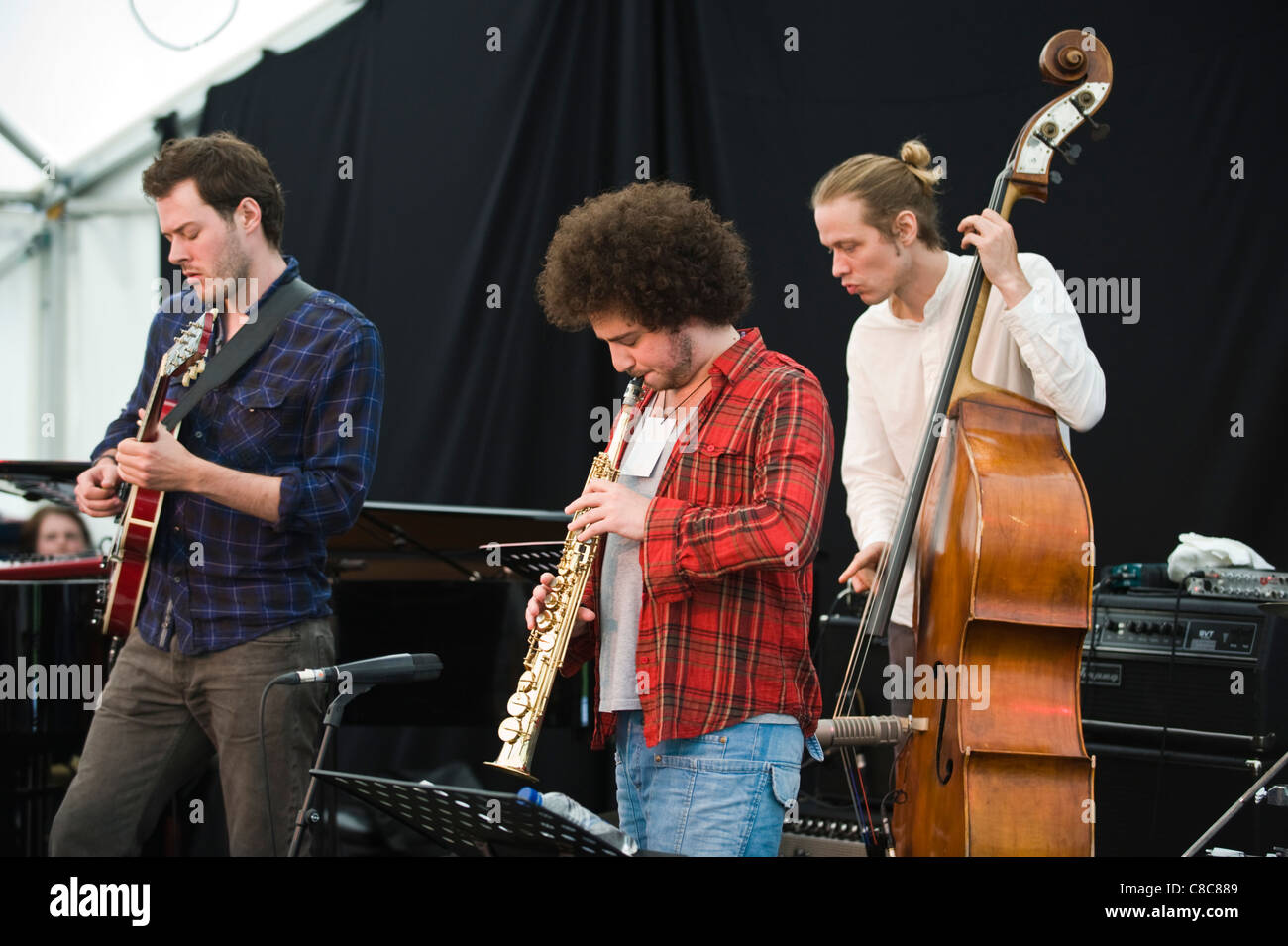 Musicians playing on stage in The Sam Crowe Group at Brecon Jazz Festival 2011 - Stock Image