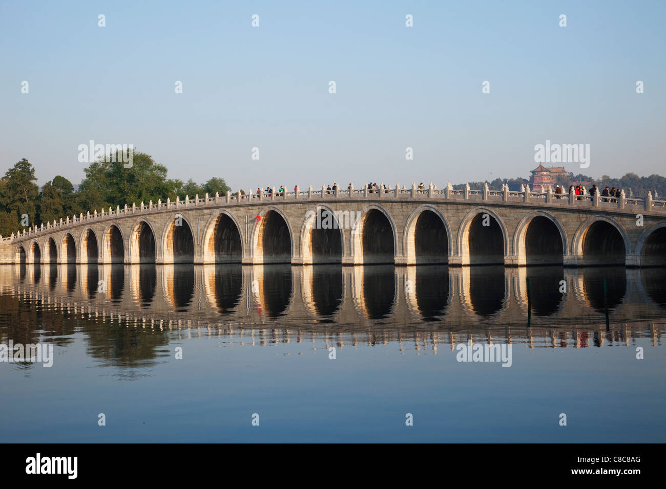 China, Beijing, The Summer Palace, Seventeen Arched Bridge - Stock Image