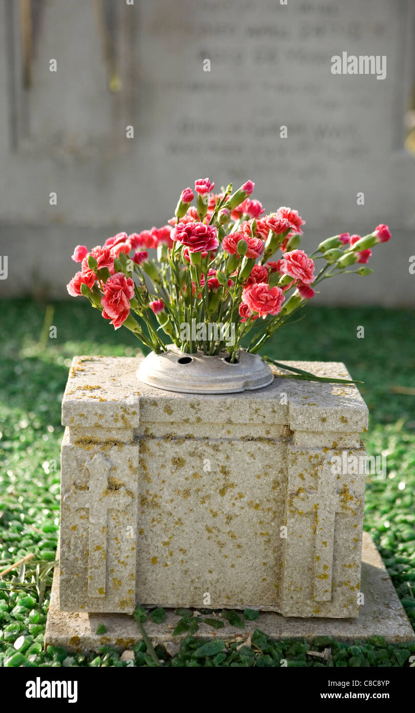 gravestone with flowers christianity religion - Stock Image