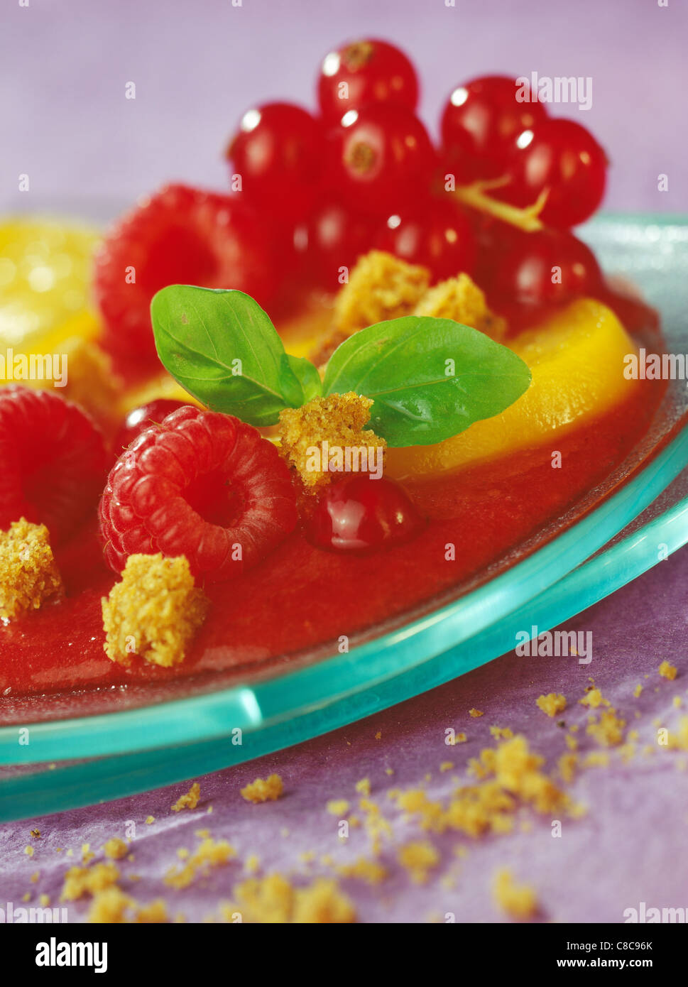Fruit and tomato gaspacho with gingerbread - Stock Image