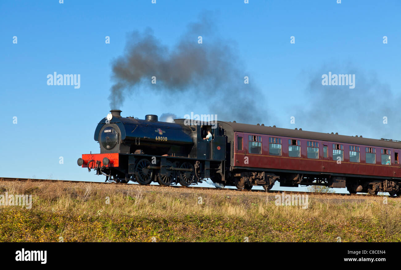 Steam engine and train on The North Norfolk Railway The Poppy line Norfolk East Anglia England UK GB EU Europe - Stock Image