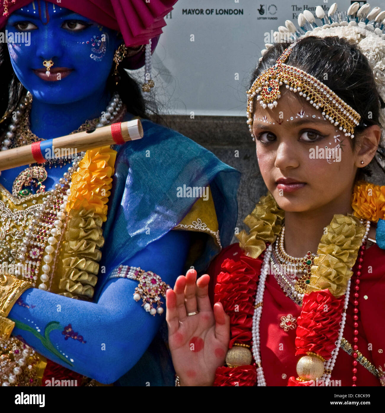 Girls in costumes of Krishna and his mistress/wife -Radha,The Rathayatra Chariots Festival - Stock Image