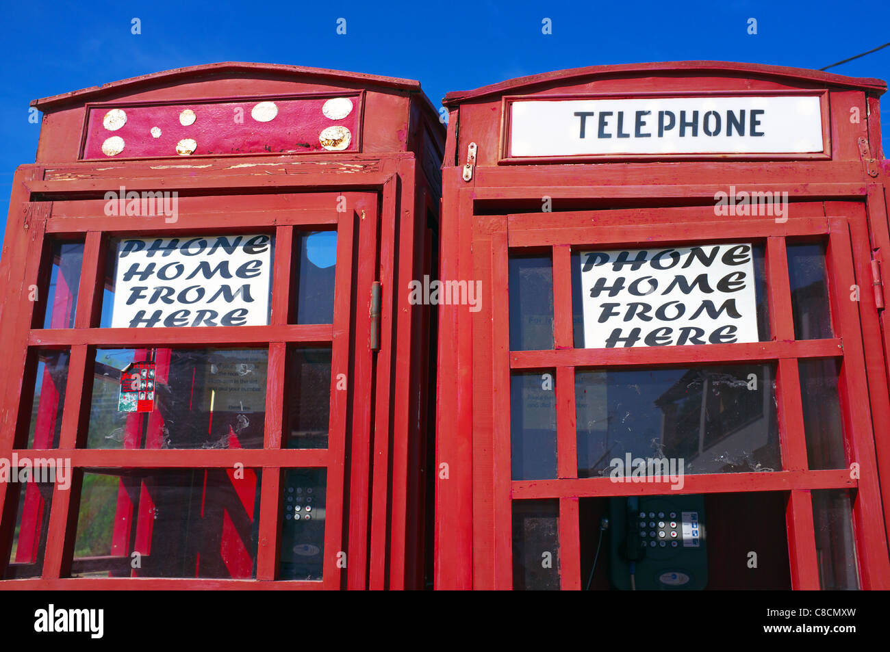 Homemade telephone box, to mimic the old styled British telephone kiosk, on the beach at Sidari, Corfu, Greece - Stock Image