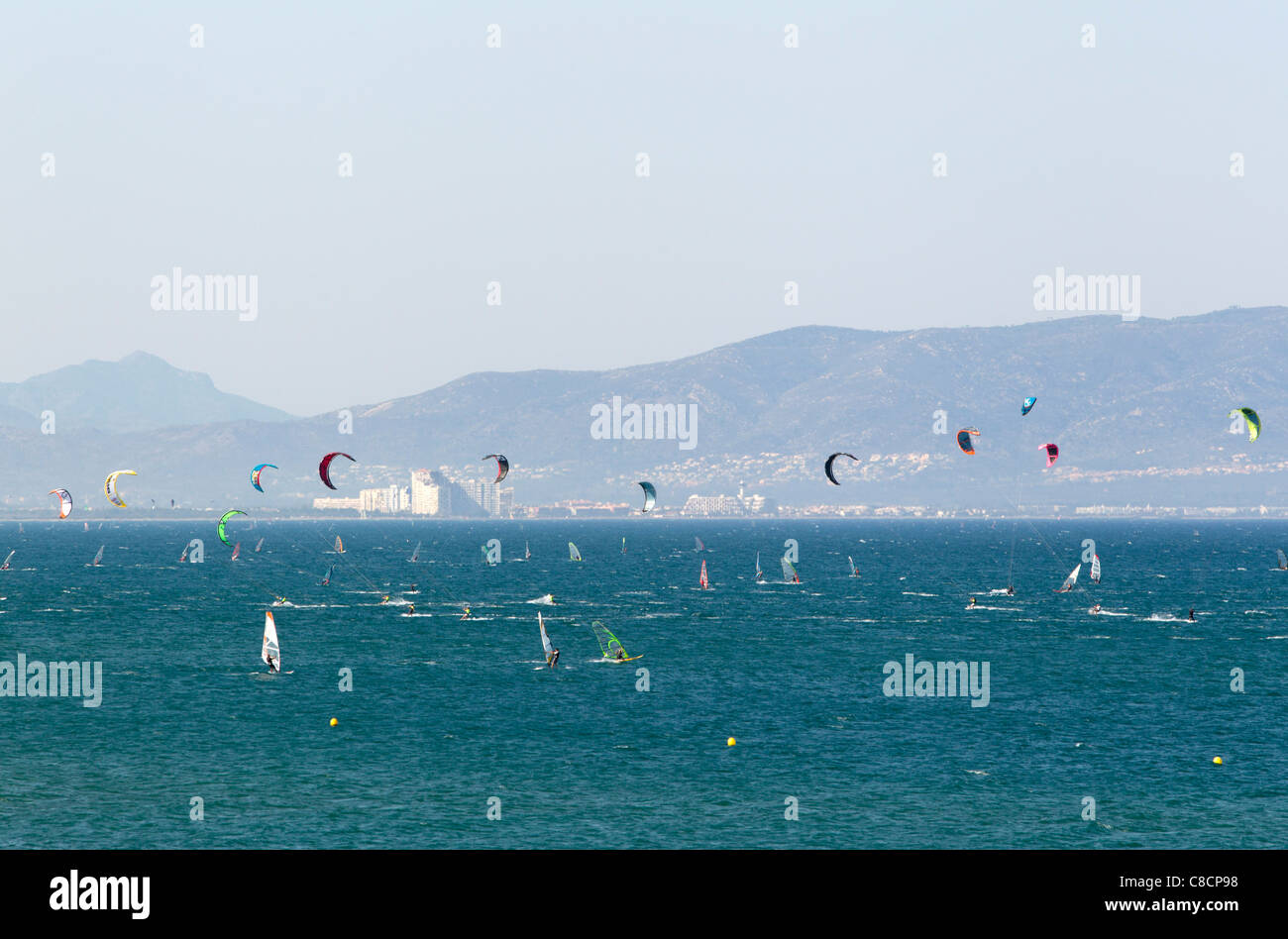 Kitesurfers and windsurfers at Sant Pere de Pescador, Costa Brava, Spain - Stock Image
