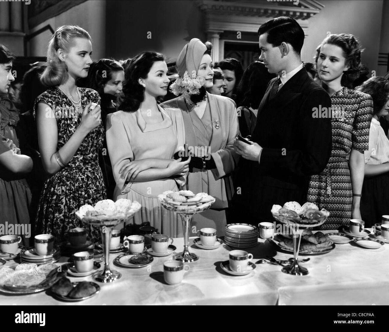 JOAN MILLER, JEAN SIMMONS, URSULA JEANS, NIGEL BUCHANAN, INGRID FORREST, THE WOMAN IN THE HALL, 1947 - Stock Image