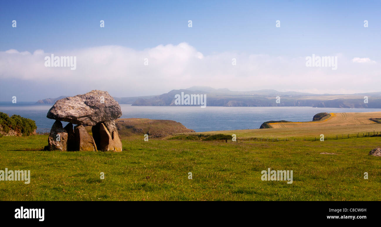 Carreg Samson Neolithic burial chamber or cromlech Near Abercastle Strumble Head in background Pembrokeshire Wales - Stock Image