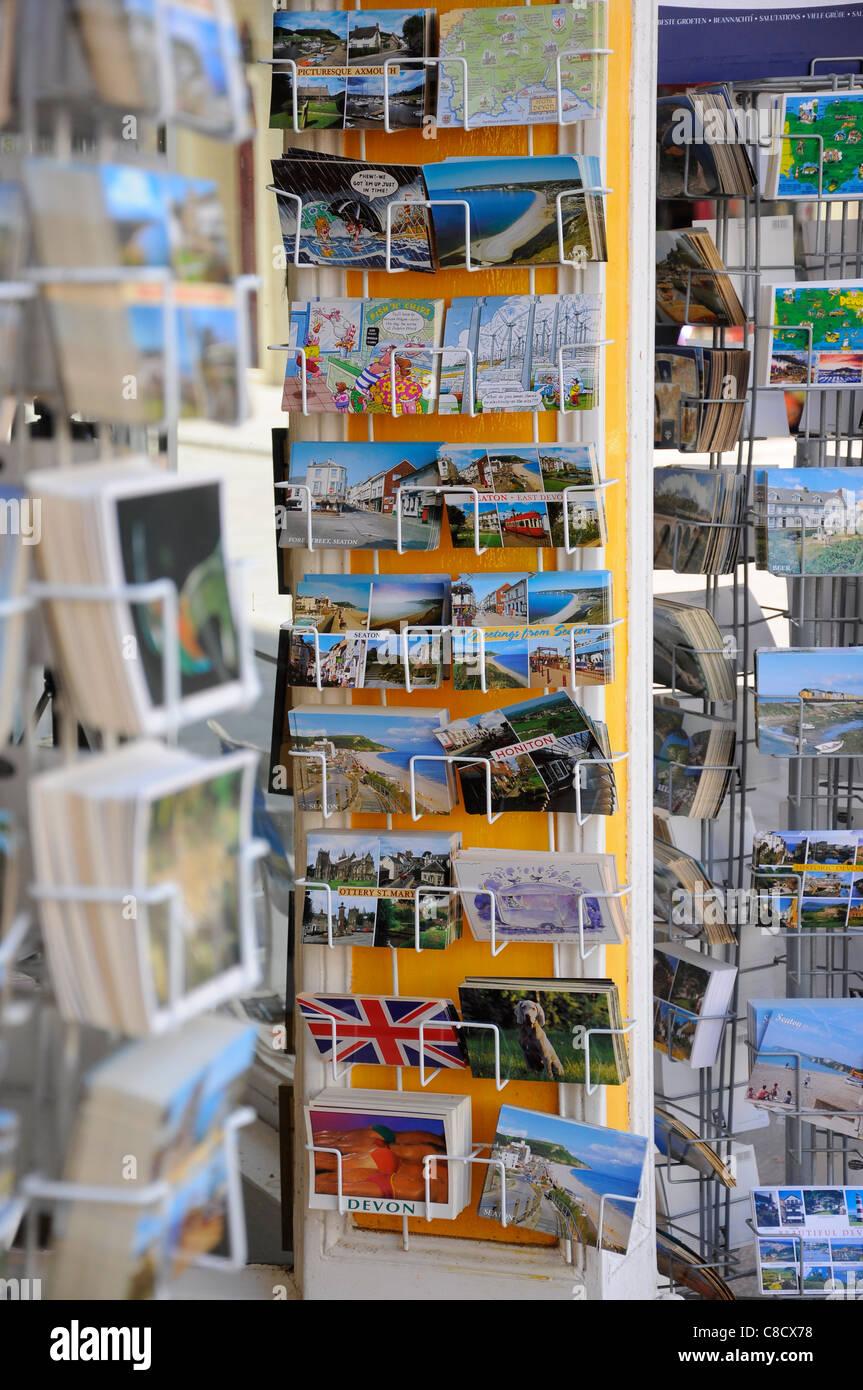 Postcards displayed outside shop in postcard racks - Stock Image