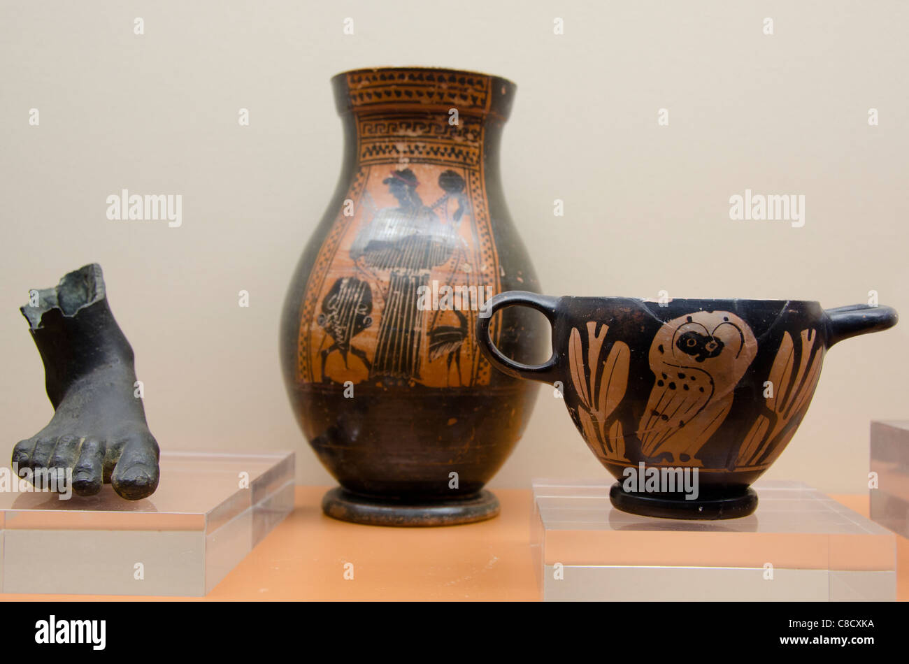 Ukraine, Odessa. Archaeological Museum, interior display. 6th-4th century BC, bronze foot from statue, Greek pottery. - Stock Image