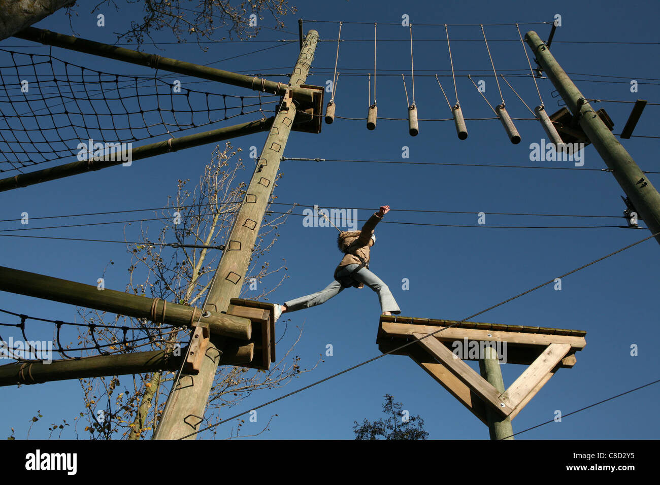 Aerial Extreme's High Ropes Adventure Courses at Willen Lake in Milton Keynes, England, UK. - Stock Image
