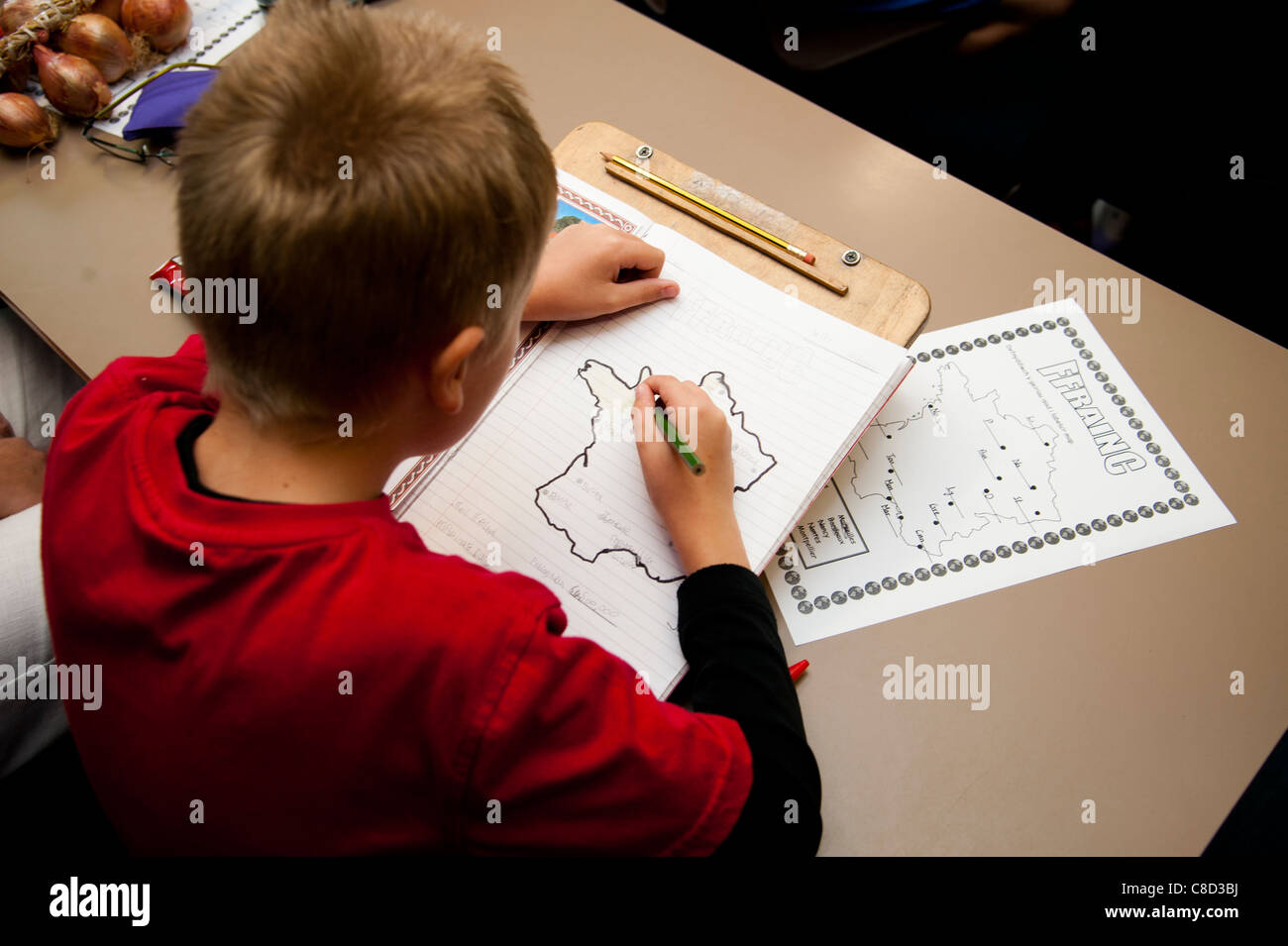 a Child in geography class at a primary school Wales UK, learning about France and the French - Stock Image