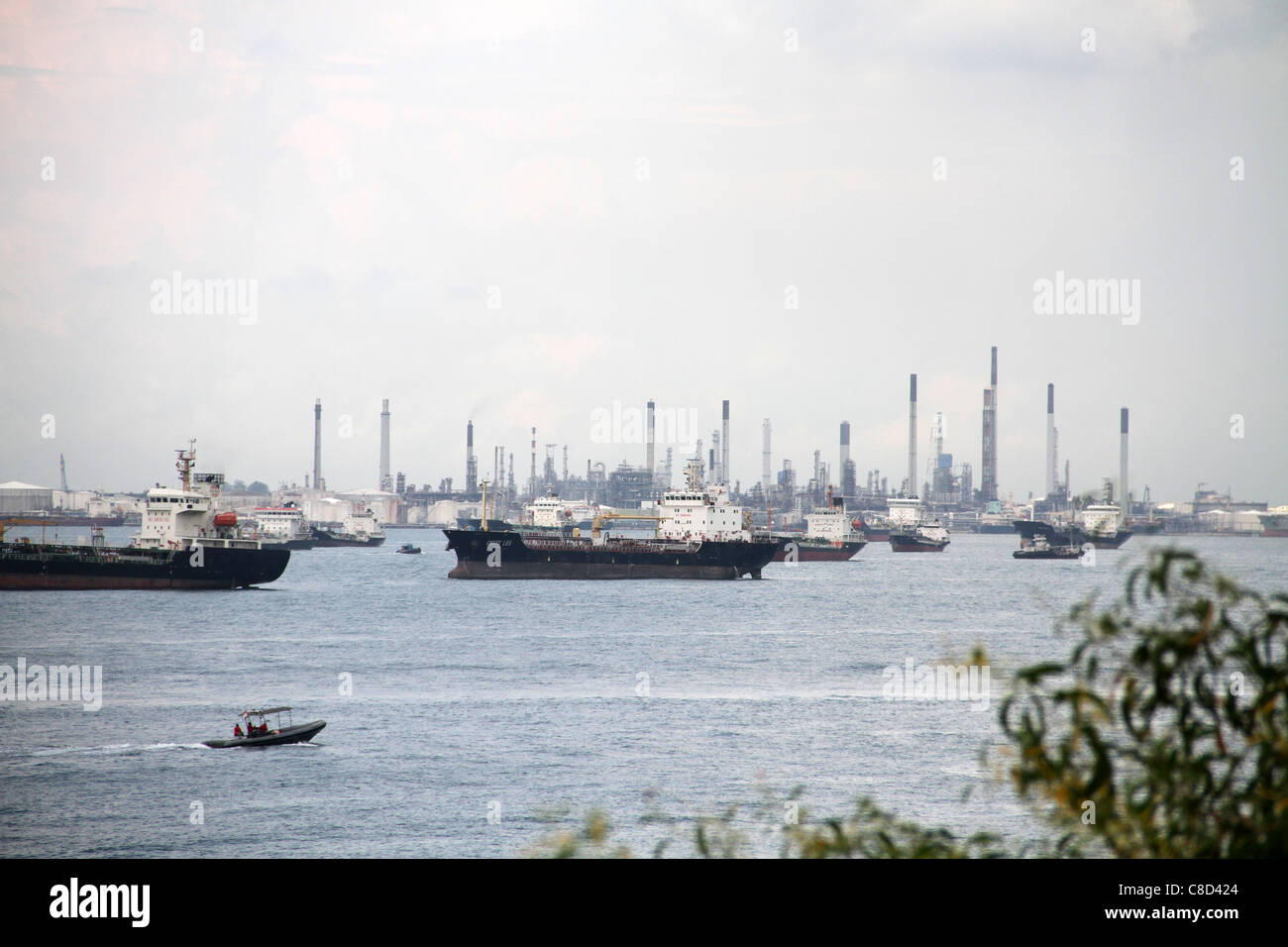 Container vessels near the Port of Singapore, South China Sea. - Stock Image