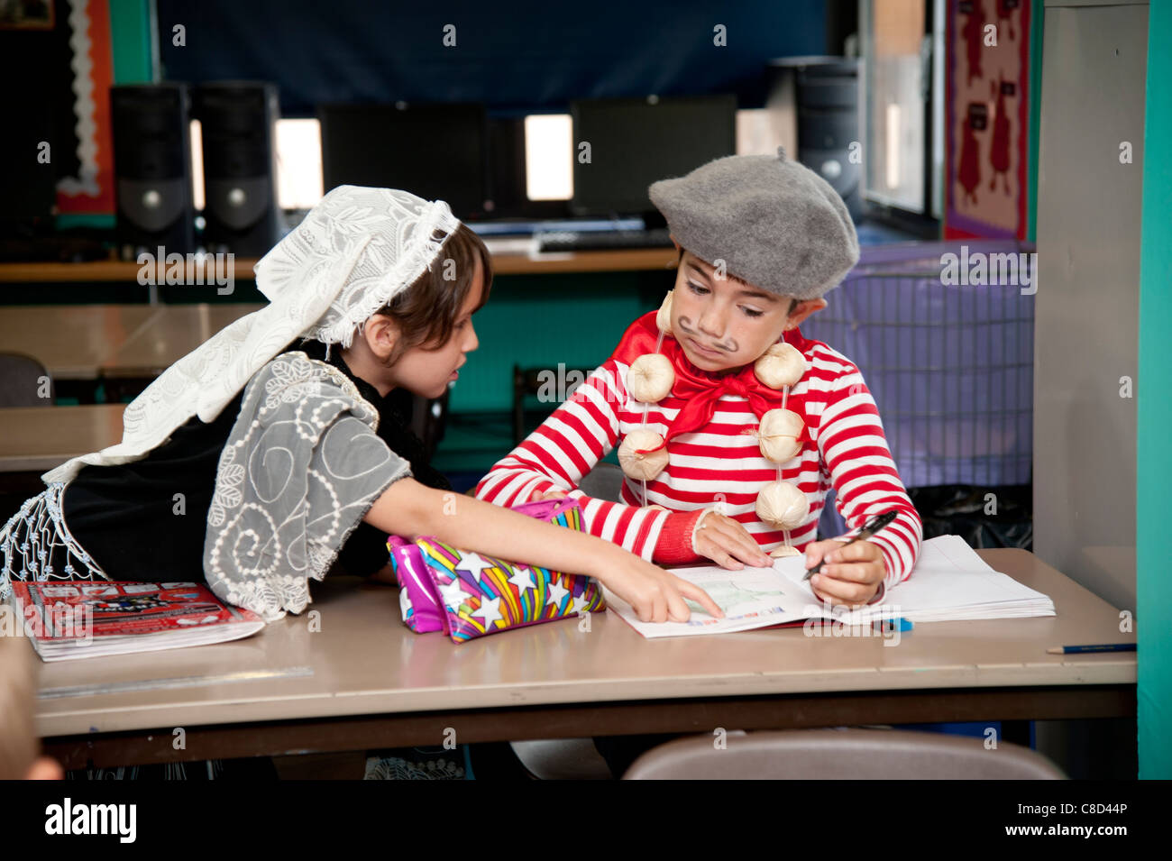 International Day - two children wearing French dress costume  in class at a primary school Wales UK - Stock Image