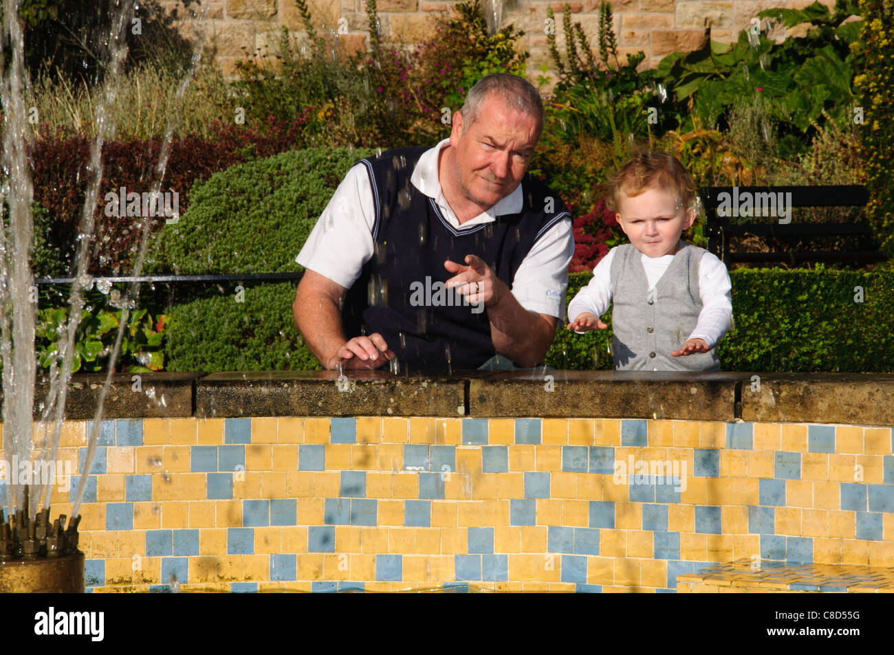 a grown man father son young child posing for portraits around belfast castle - Stock Image