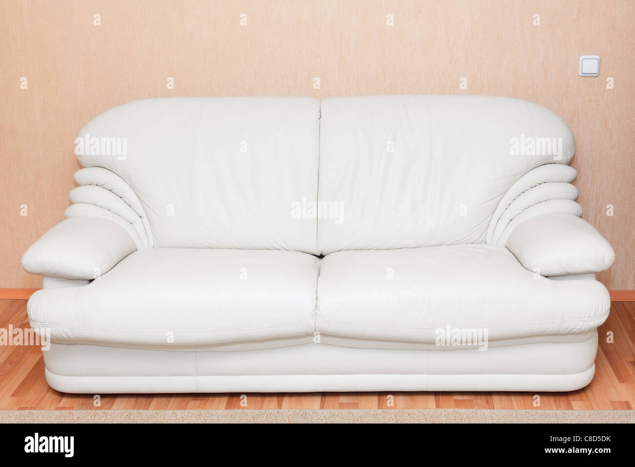 White leather couch in the room interior. Nobody - Stock Image