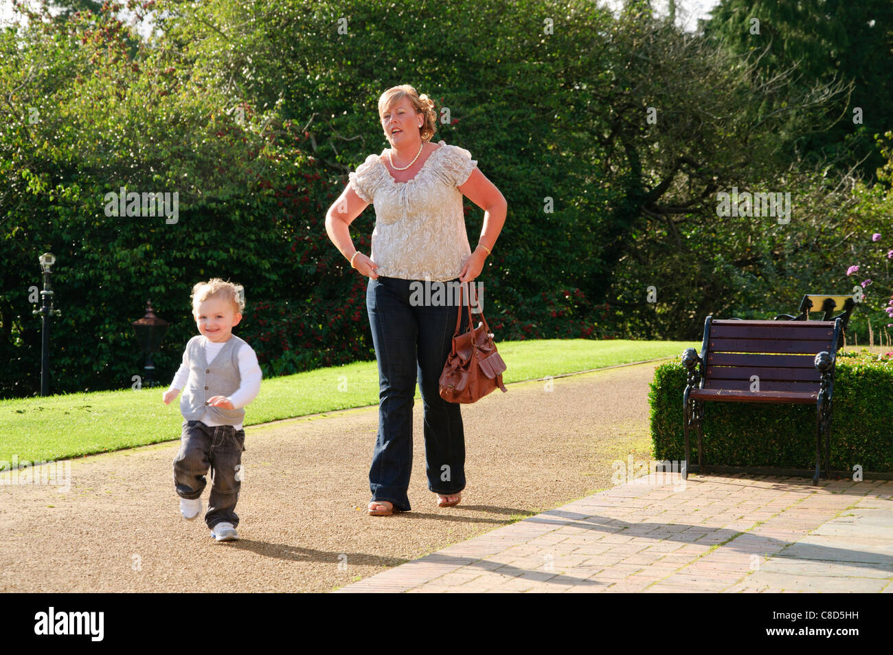 a grown woman mother son young child posing for portraits around belfast castle - Stock Image