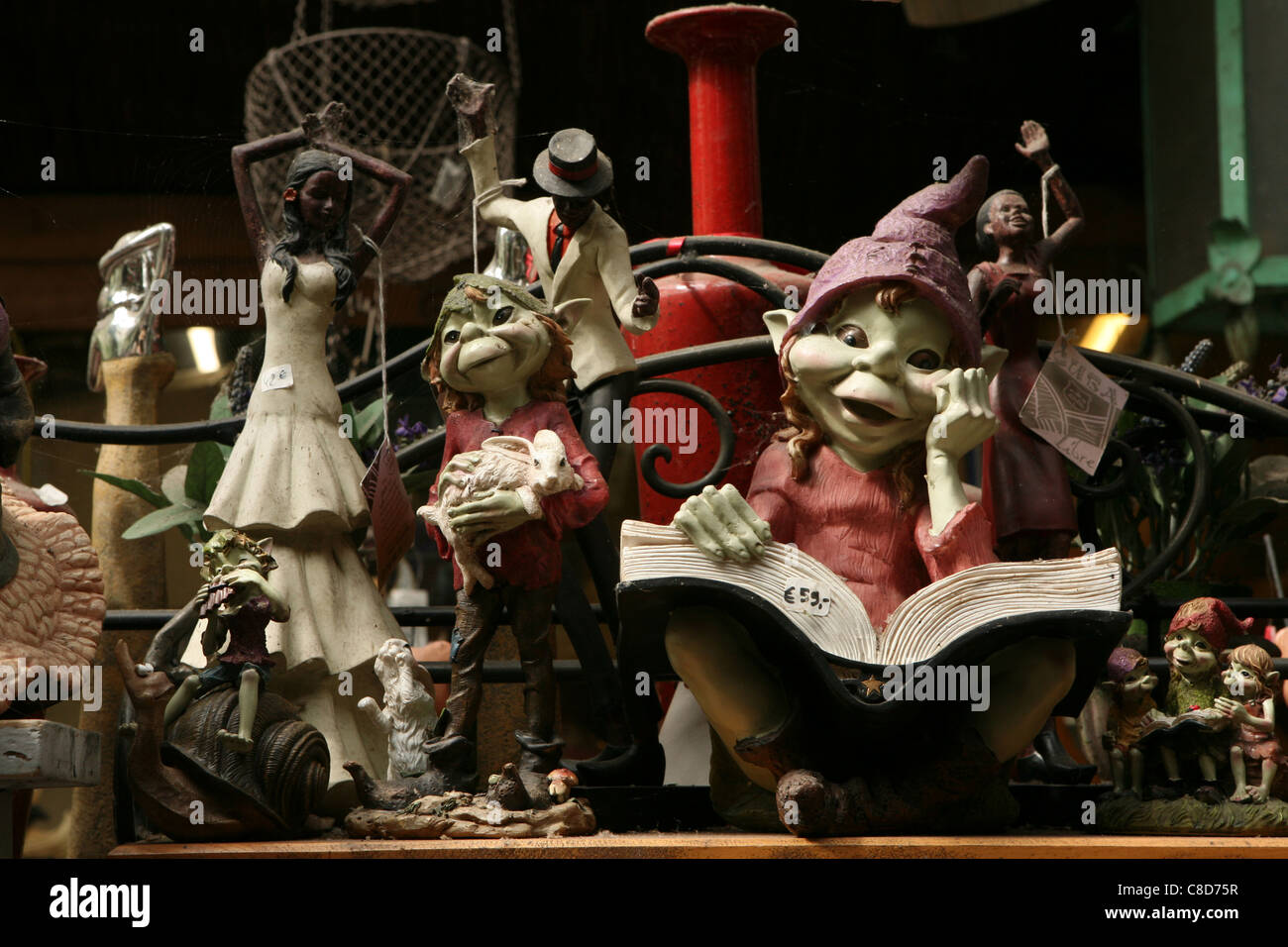 Garden statuette of dwarfs at the flower market on Place Louis-Lepine in Paris, France. - Stock Image