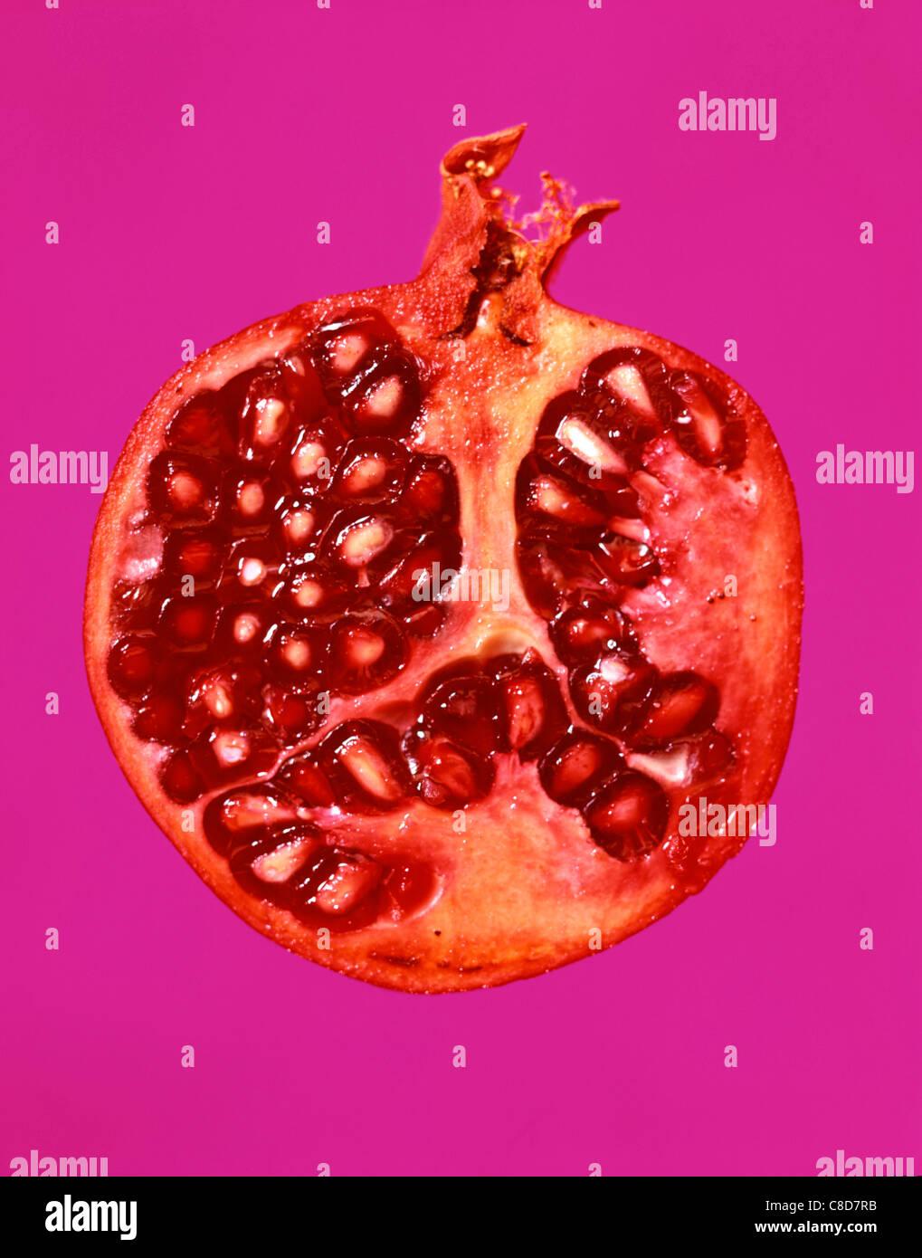 Sliced pomegrante - Stock Image