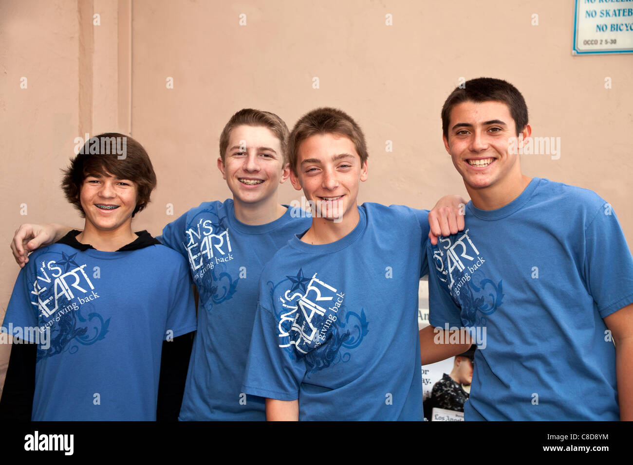 young person people Four teen boys in the Lion's heart Boys Club Hanging out smile for camera. Inside editorial - Stock Image