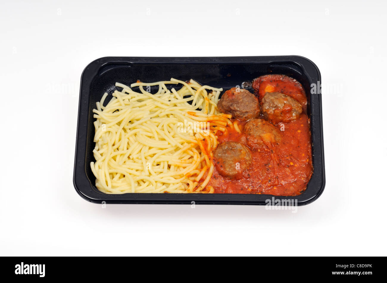 Tray of spaghetti with tomato sauce and meatballs ready meal. - Stock Image
