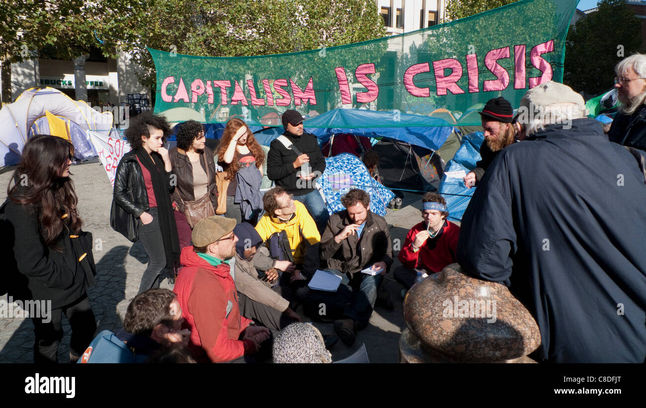 A group of protesters at the Occupy Movement demonstration 19/10/2011 gather to discuss future strategy for the - Stock Image