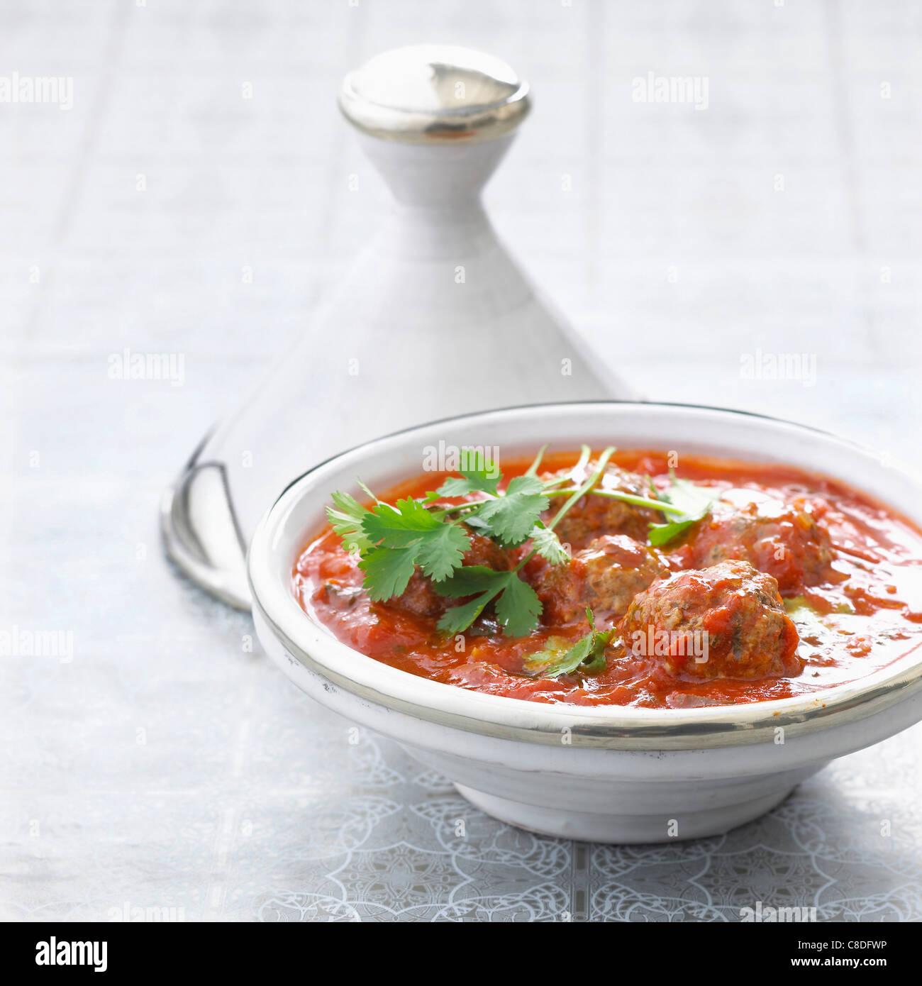 Beef meatballs and  tomato sauce Tajine Stock Photo