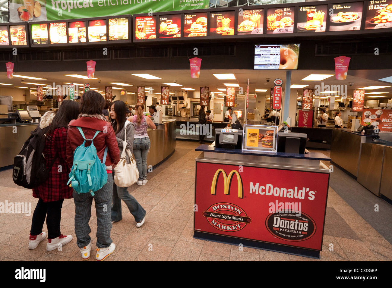 Teenage american girls at a fast food court with McDonalds, and Donatos, Washington DC USA - Stock Image