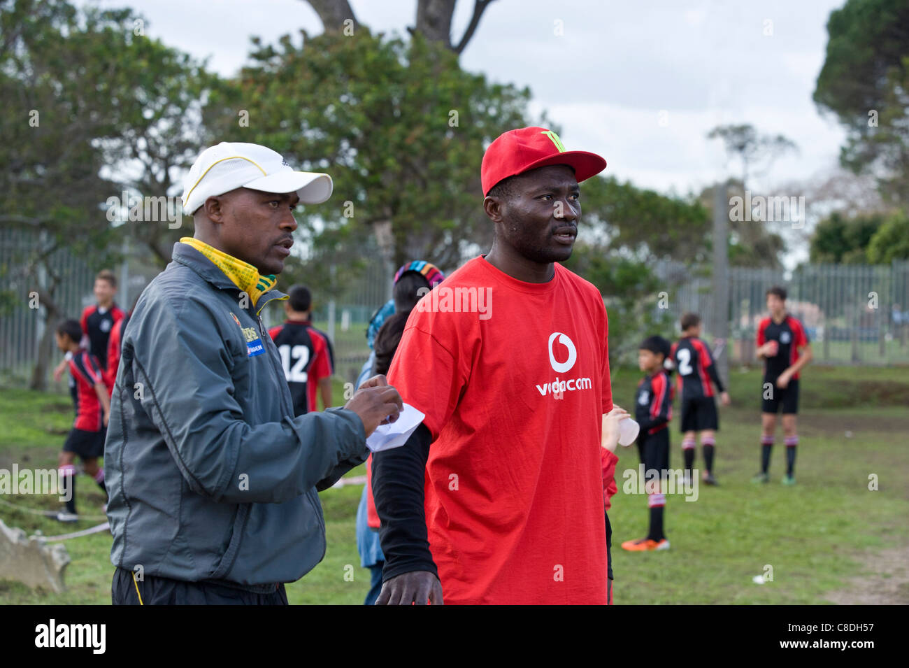 Football coaches watching a match of a youth team in Cape Town South Africa Stock Photo