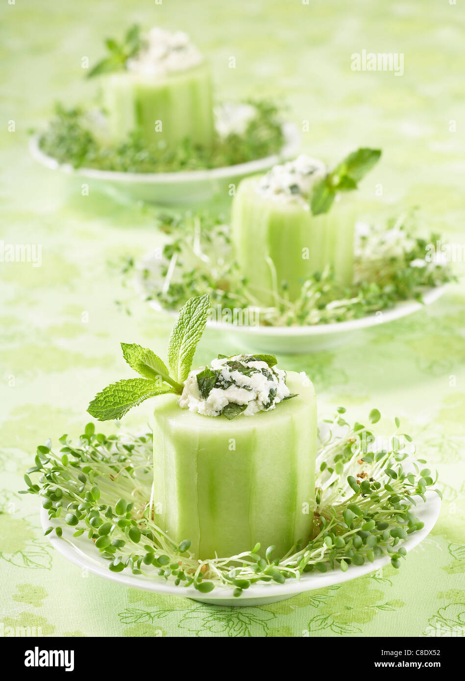 Slices of cucumber stuffed with fromage frais and fresh mint - Stock Image
