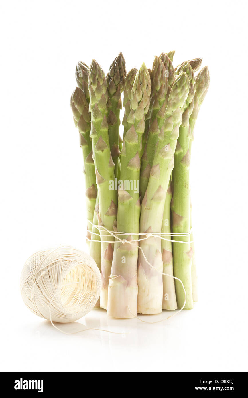 Bunch of green asparagus tied with string - Stock Image