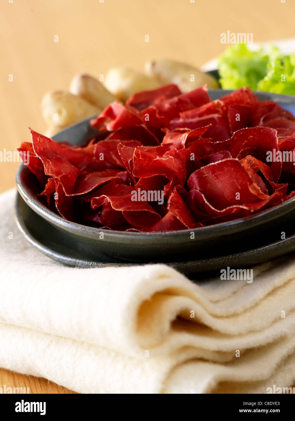 Thinly sliced grisons meat - Stock Image