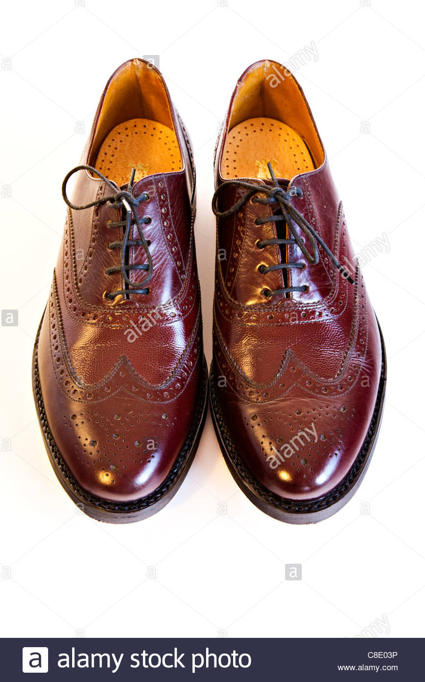 Men's brown polished leather lace up shoes on white background - Stock Image