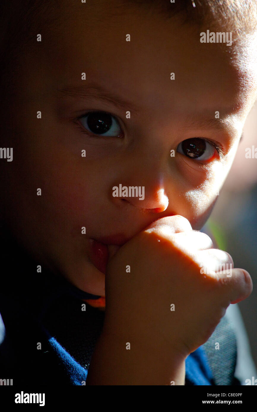 Little boy sucking his thumb Stock Photo