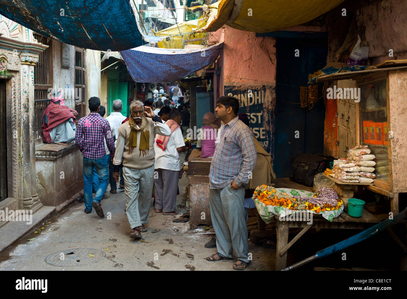 Indian people in alleyway in the holy city of Varanasi, Benares, Northern India - Stock Image