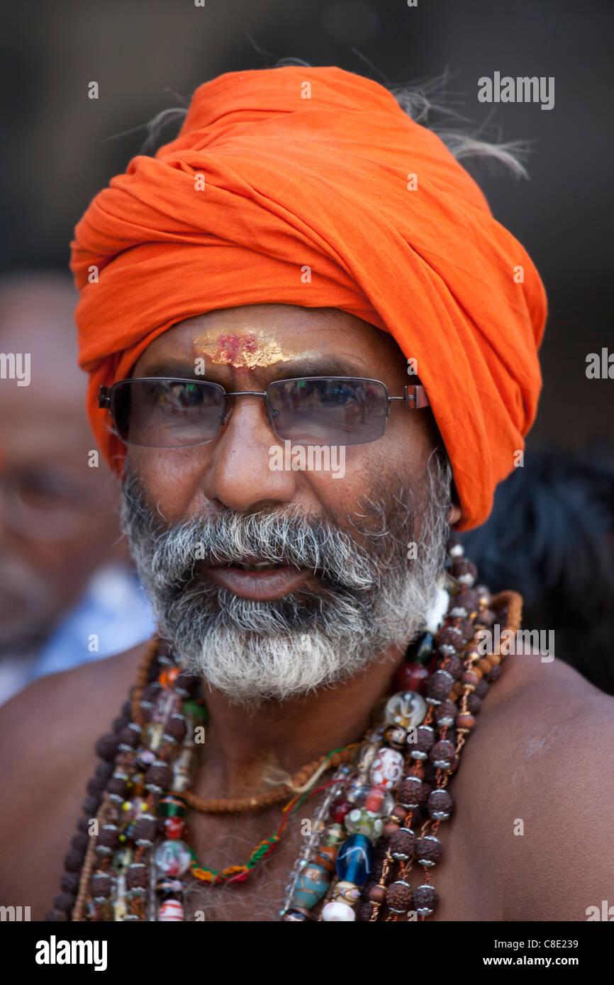 Hindu sadhu pilgrim with beads and turban in holy city of Varanasi, Benares, India - Stock Image