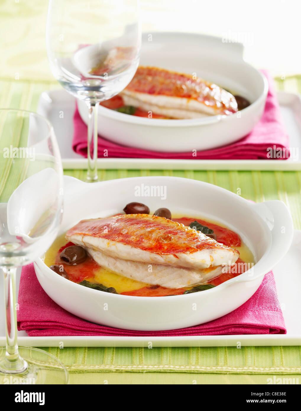 Oven-baked red mullet fillets - Stock Image