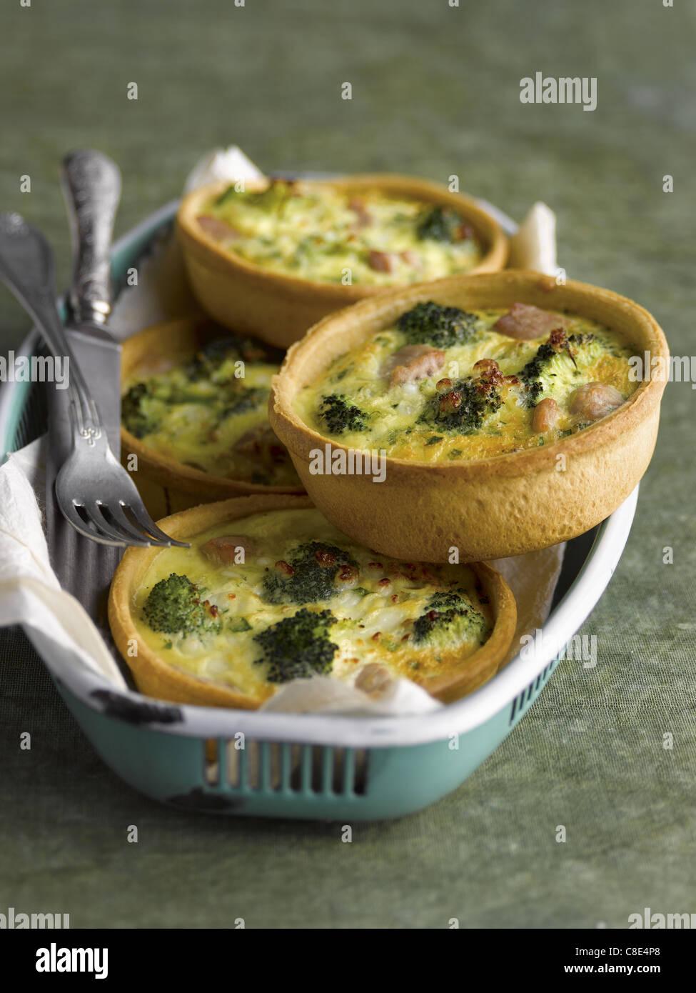 Broccoli and tuna mini quiches Stock Photo