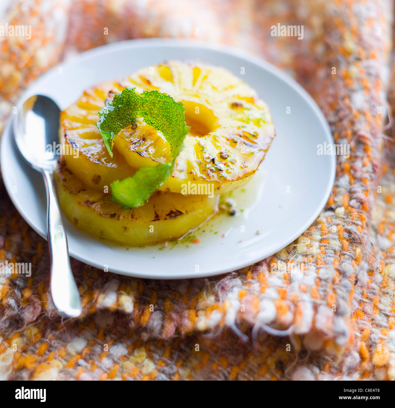 Caramelized pineapple slices with lime - Stock Image
