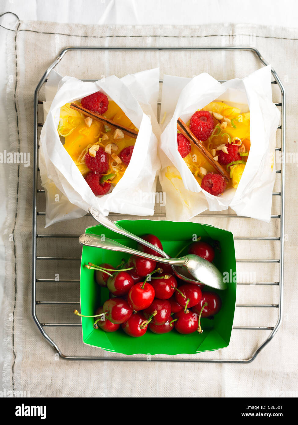 Fruit cooked in wax papper - Stock Image