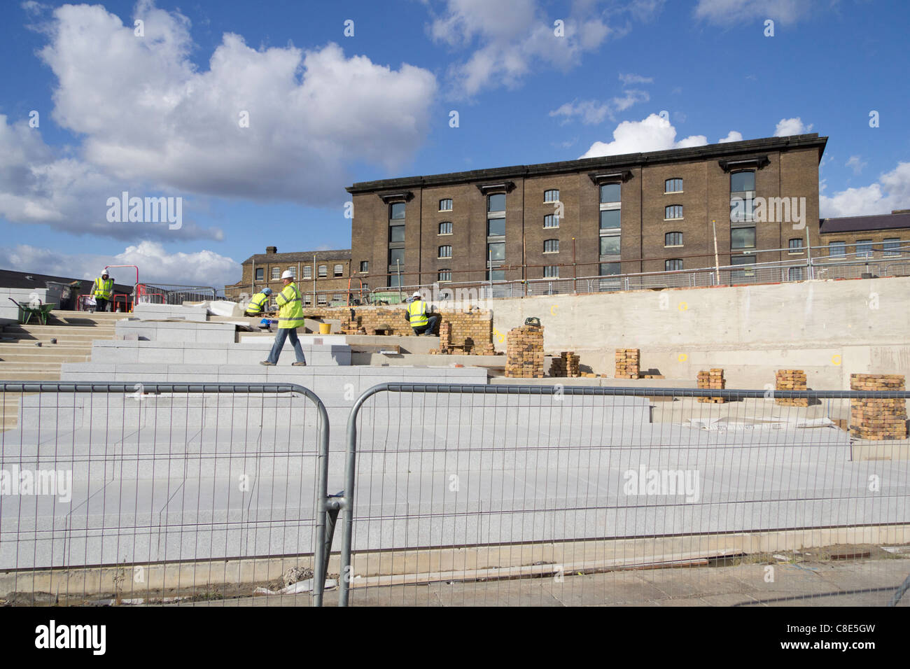 Hard landscaping work being carried out on the banks of the Regents Canal at the Kings Cross development, Stock Photo