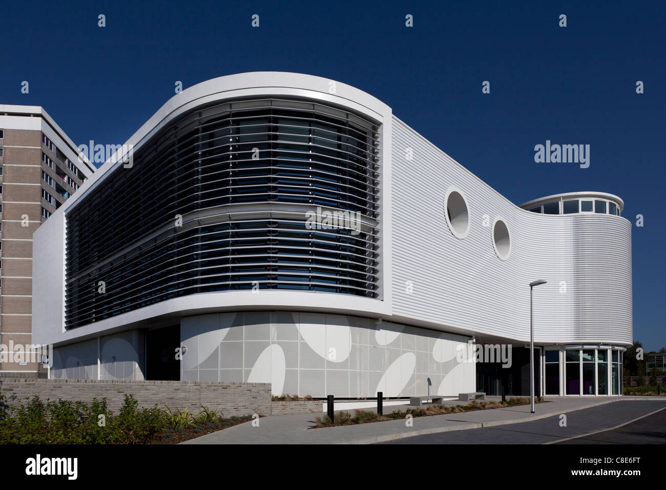 The curved and louvered, white exterior of the Eastpoint Centre in Southampton. - Stock Image