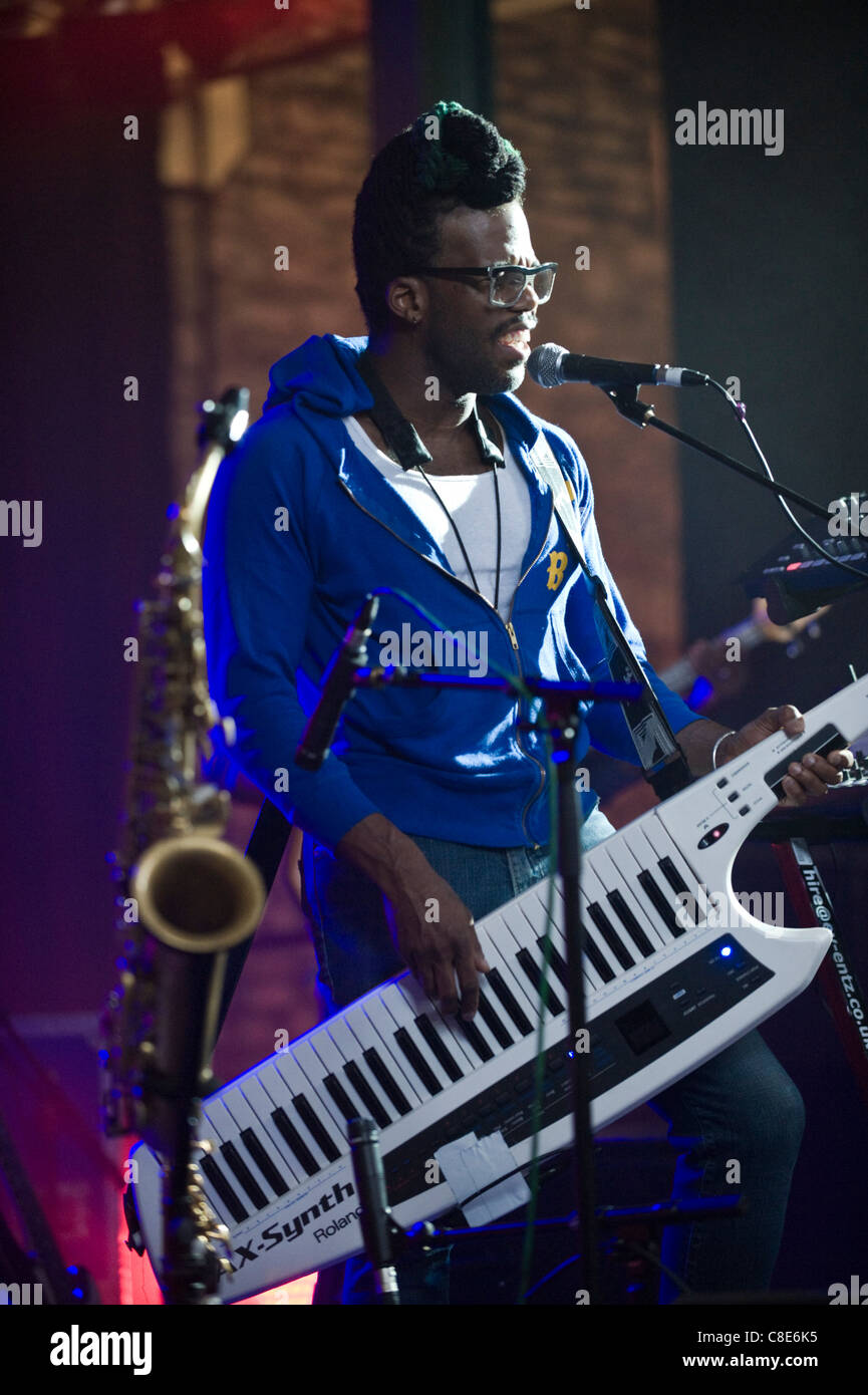 Casey Benjamin playing a Roland AX-Synth shoulder synthesizer on stage with Robert Glasper Experiment Brecon Jazz - Stock Image