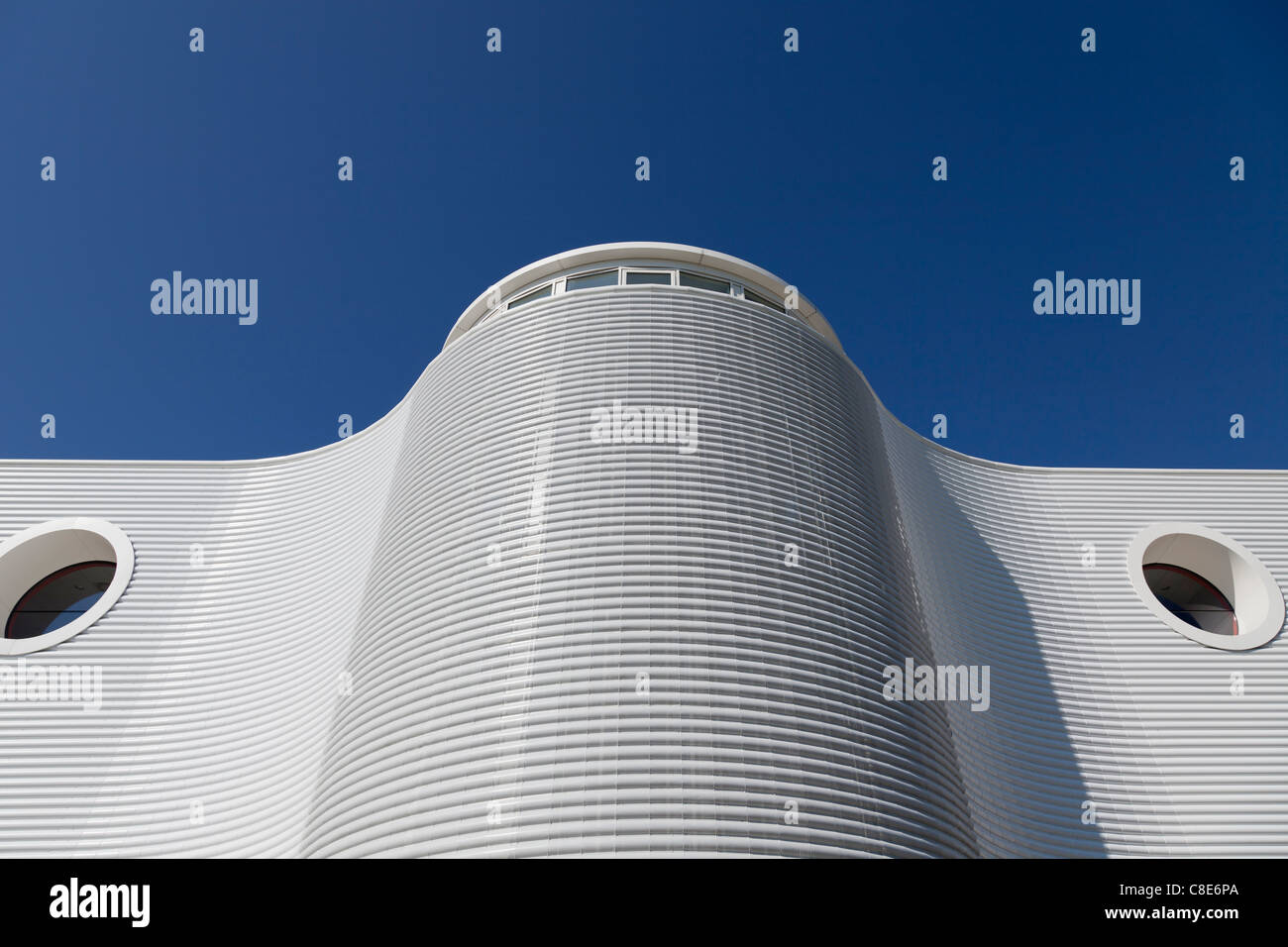 the curved and louvered, white exterior of the Eastpoint Centre in Southampton - Stock Image