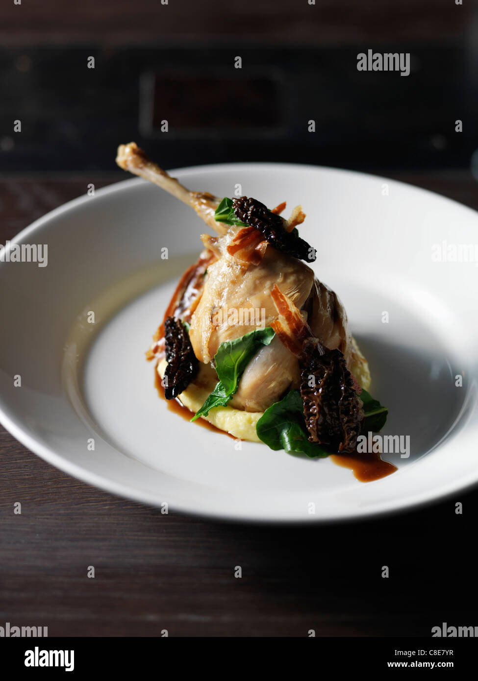 Duck with morels,pancetta and spinach - Stock Image