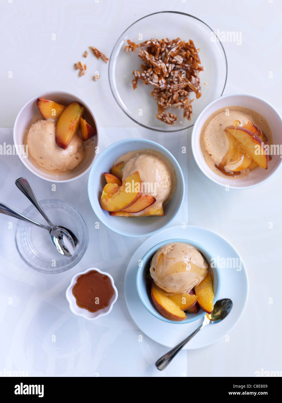 Dishes of ice cream with peaches - Stock Image